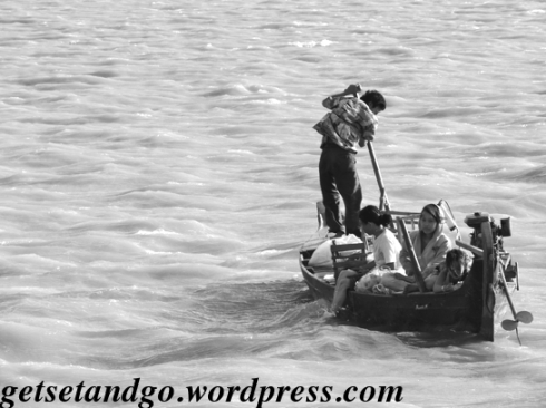 An entire family on a boat - Mekong River