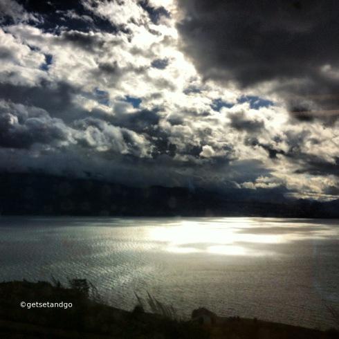 Sun bursting through the clouds on Lake Geneva, near Lausanne, Switzerland