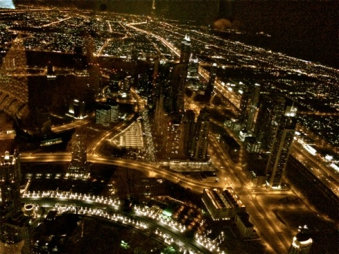 The Palm Jumeirah is on the   extreme right hand side corner of the pic but not visible in the dark, from Burj Khalifa